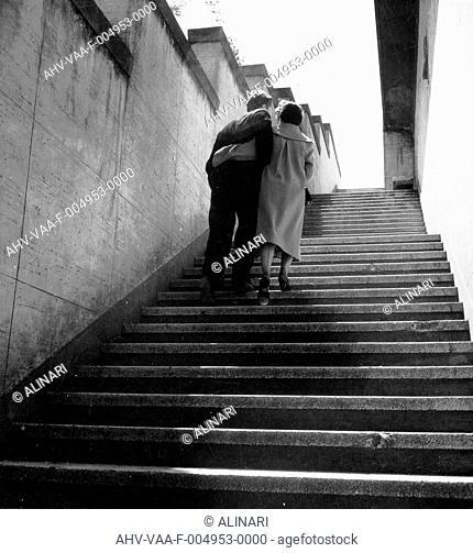 Embracing couple climbs stairs, shot 1960 ca. by Villani, Studio