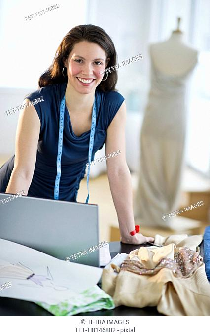 Portrait of young fashion designer at work