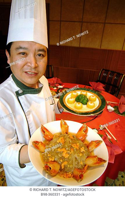 St. Regis Hotel's Chinese restaurant: chef with lobster claws. Beijing. China