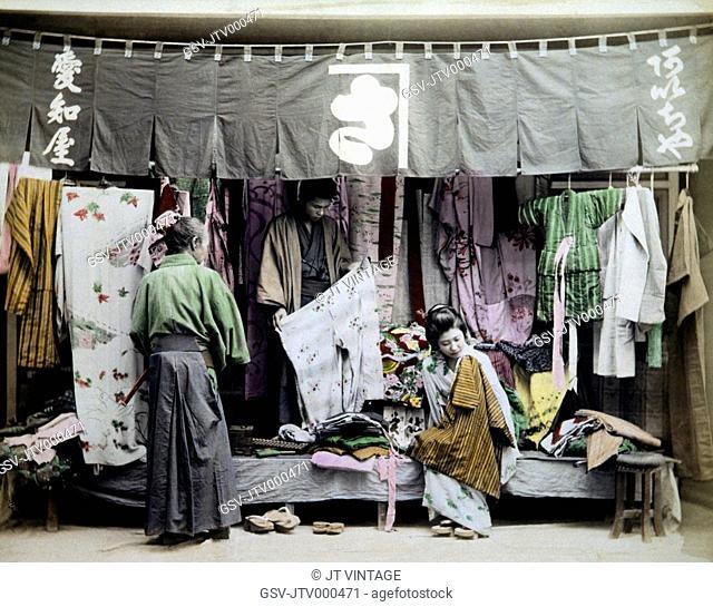 Japanese Street Vendor of Clothing, Hand Colored Albumen Photograph, Circa 1880