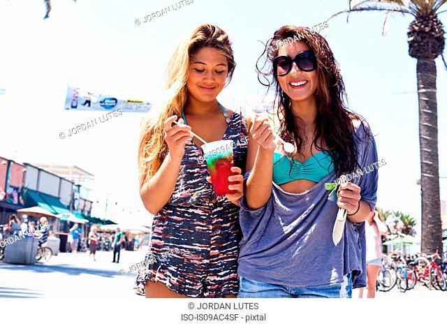 Female friends with iced drink, Hermosa Beach, California, USA