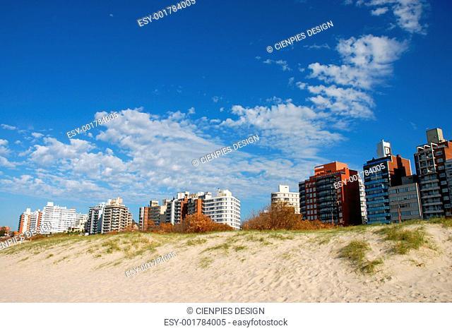 Buildings a sand dune beach panorma