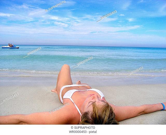 Woman relaxing beach