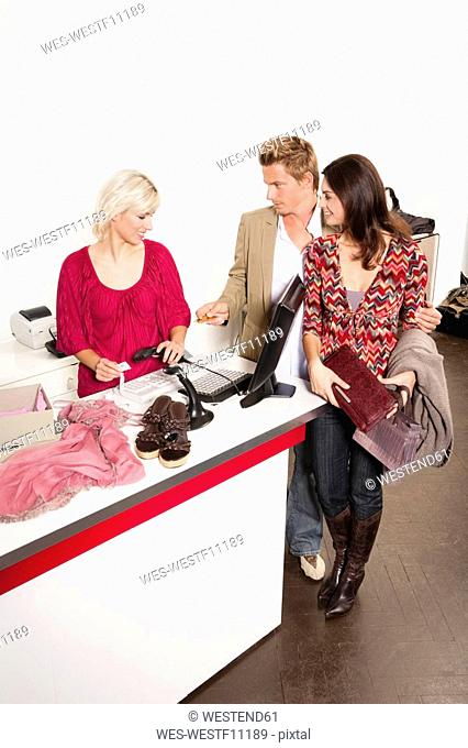 Couple paying at cashier