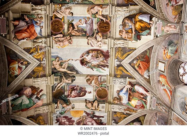Low angle interior view of Michelangelo's ceiling in the Sistine Chapel in Vatican City, Rome