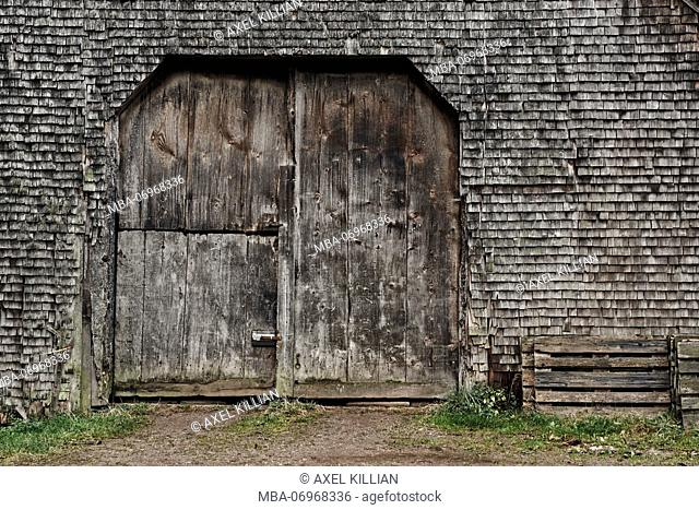 old shingles and gate, grey and weathered on a wooden house in the Black Forest, detail