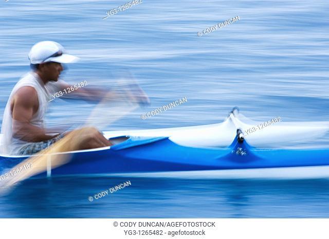 person rows outrigger canoe, Morea, Tahiti