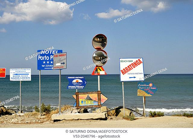 Advertising signs and road mirrors at seafront, Agios Giannis, Limnos, Greece