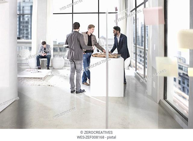 Businessmen talking at office reception