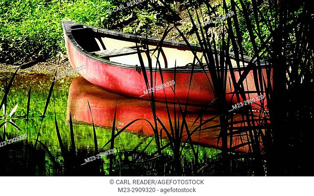 An old rowboat waits for its next use, Pennsylvania, USA