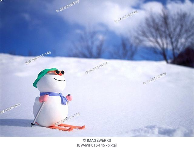 Snowman on skis in snow