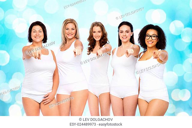 choice, friendship, beauty, body positive and people concept - group of happy different women in white underwear pointing finger on you over blue holidays...