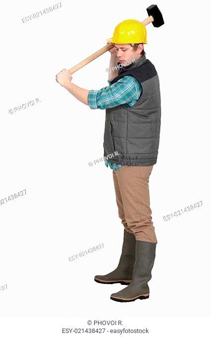 Builder holding hammer over head