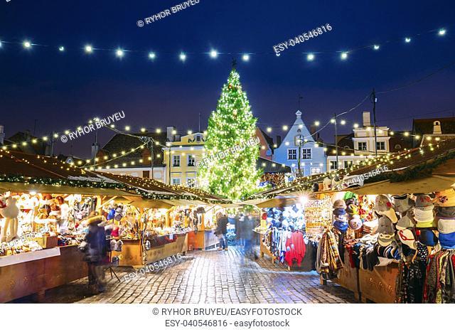 Tallinn, Estonia. Traditional Christmas Market On Town Hall Square - Raekoja Plats. Christmas Tree And Trading Houses. Happy New Year Holiday