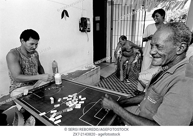 Men in Brazil play domino and talk and discuss about politics, football and community problems