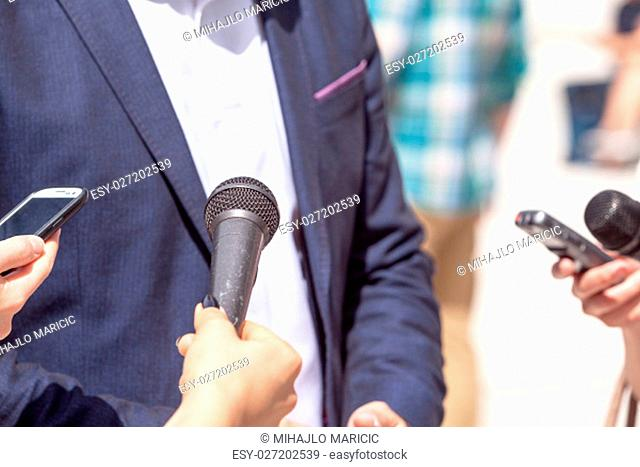 Journalists making interview with businessman, politician or spokesperson. News conference