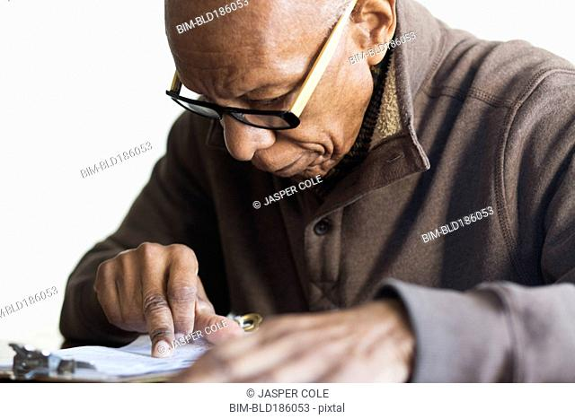 Older Black man reading notes