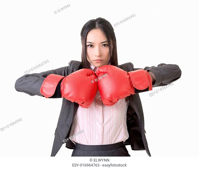 Business woman with boxing gloves, closeup portrait