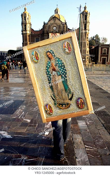A pilgrim holds a image of the Virgin of Guadalupe on his shoulders in the Basilica de Guadalupe in Mexico City. Hundred of thousands of Mexican pilgrims...