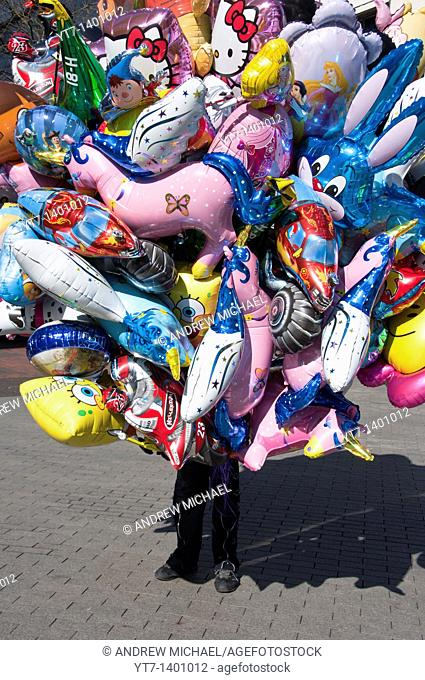 A balloon seller in Birmingham city centre  England