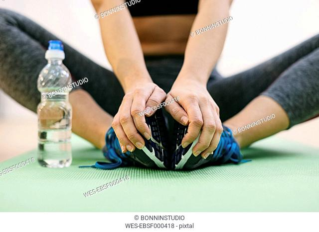 Woman doing fitness workout on gym mat