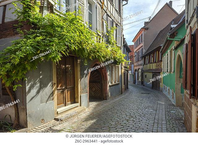 lane with old colourful houses in the village Barr, on the Wine Route of Alsace, France
