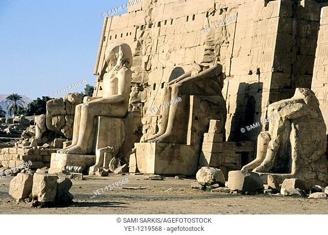 Partially ruined statues in front of the Eight Pylon at Karnak Temple, Luxor, Egypt