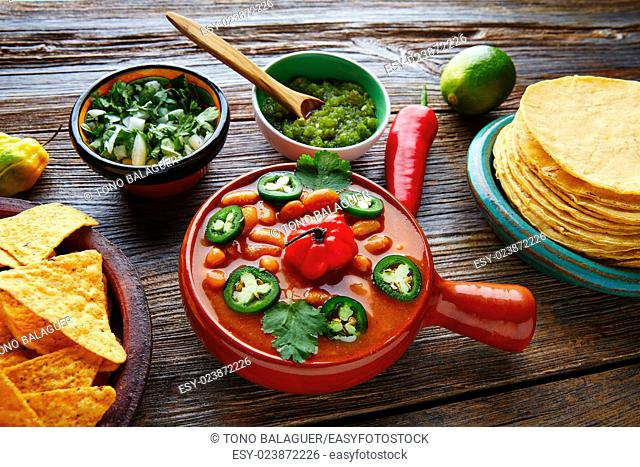Frijoles charros mexican beans with chili pepper sides and tortillas