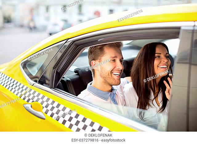 Happy couple in a taxi