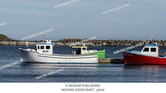 Fishing boats moored at dock, Main-a-Dieu, Cape Breton Island, Nova Scotia, Canada