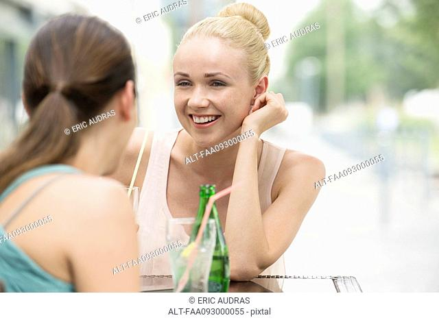 Women chatting at sidewalk cafe