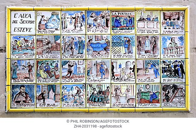 Barcelona, Spain. Carrer de Petritxol in Barri Gotic. Tiles - L'Auca del Senyor Esteve / The Story of Senor Esteve