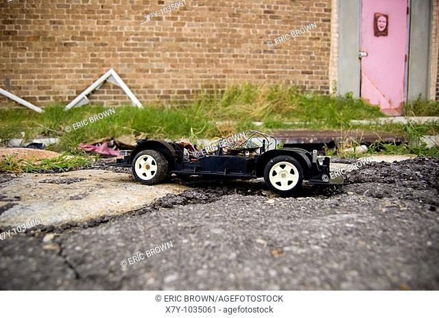 A chassis of a toy car lies on