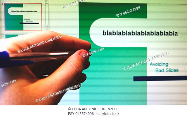 hand with pen indicates the screen with slides presentation program slideshow