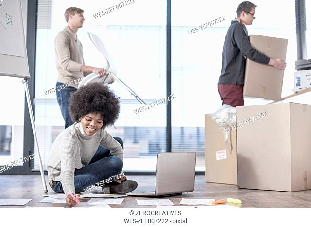 Woman working on floor in new office