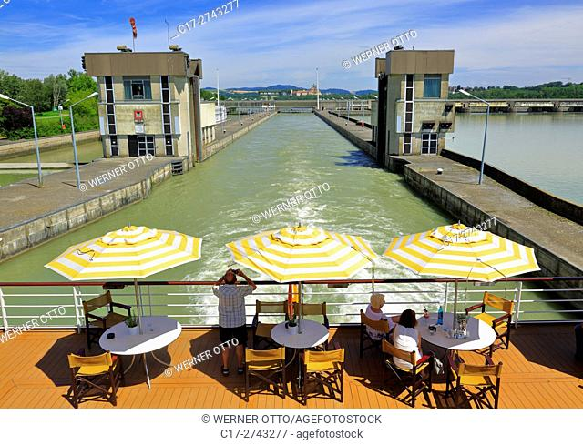 tourism, holiday, freetime, Danube river cruise, Danube navigation, open afterdeck on an aROSA cruiser, restaurant, dishes, chairs, sunshades, people, tourists