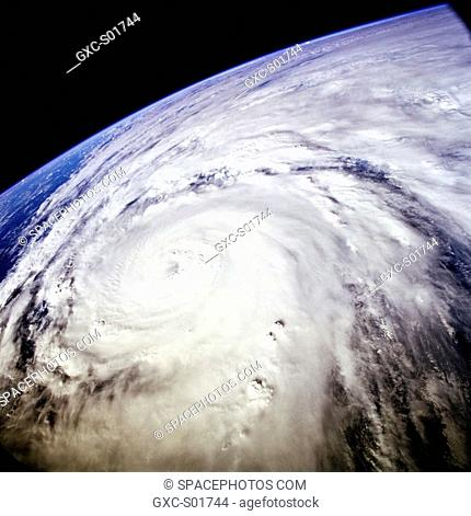 Typhoon Saomai swirls in the Pacific Ocean east of Taiwan and the Philippines. The typhoon was captured on film with a 70mm handheld camera by the STS-106 crew...