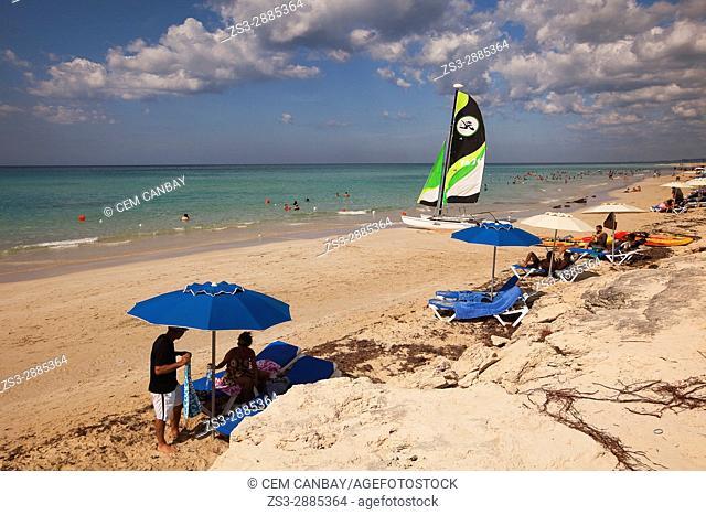 Scene from the Santa Maria del Mar beach with a catamaran at the background, Playas del Este, La Habana, Cuba, West Indies, Central America