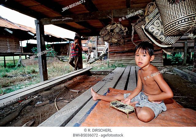 punan child sitting in hut, Malaysia, Borneo, Gunung Mulu NP