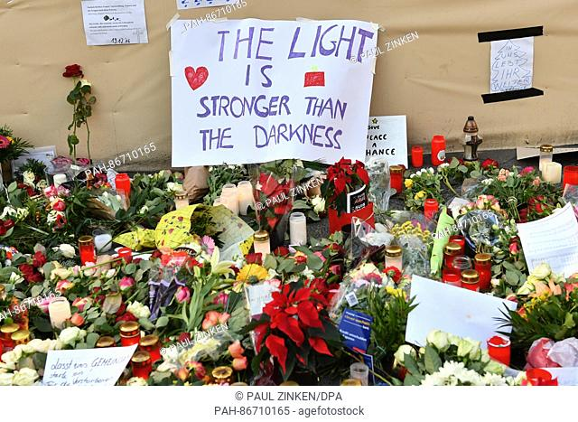 """A sign reads """"""""The light is stronger than the darkness"""""""" near the site of the attack at the Christmas market at Breitscheidplatz in Berlin, Germany"""