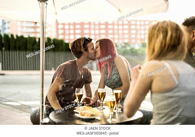 Young couple kissing in bar