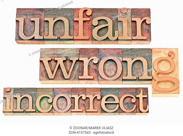 unfair, wrong, incorrect - negative words - isolated text in vintage letterpress wood type blocks