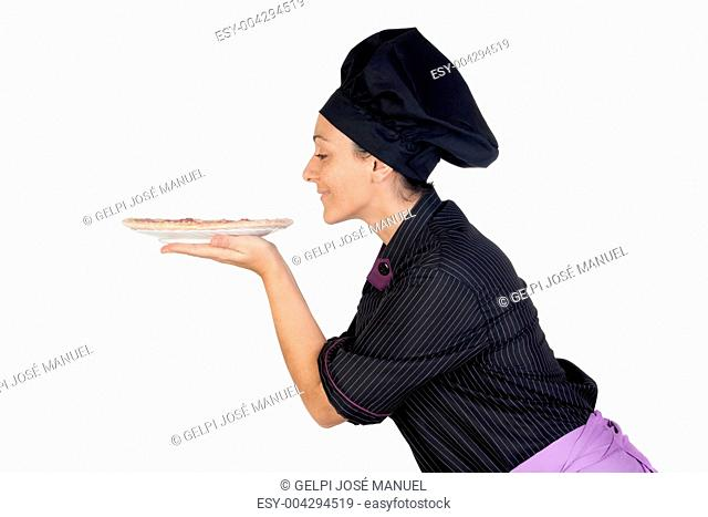 Pretty cook woman smelling ham pizza