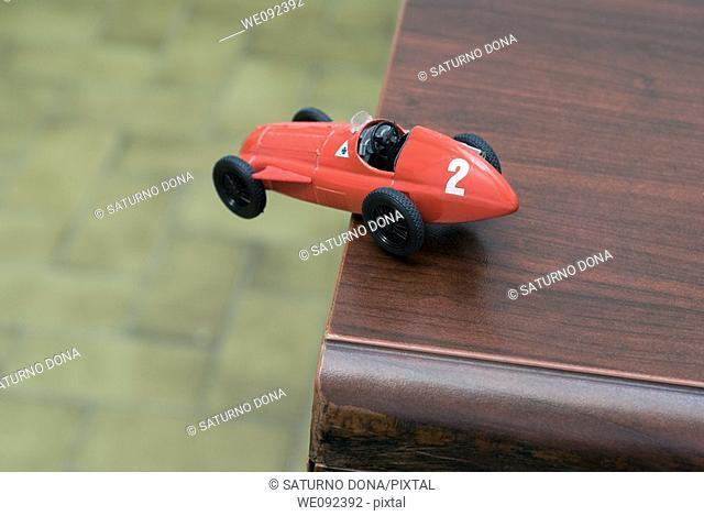 racing car in dangerous situation
