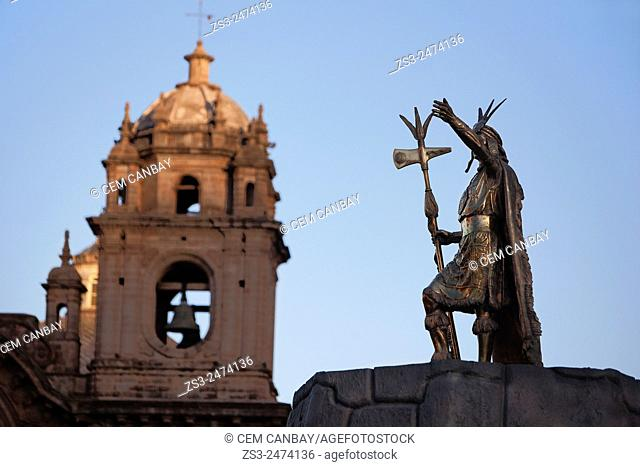 Statue of Pachacutec Yupanqui, the 9. th Inca king, with the cathedral at the background in Plaza de Armas, Cuzco, Cusco, Peru, South America