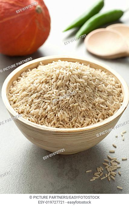 Raw brown rice in a bowl