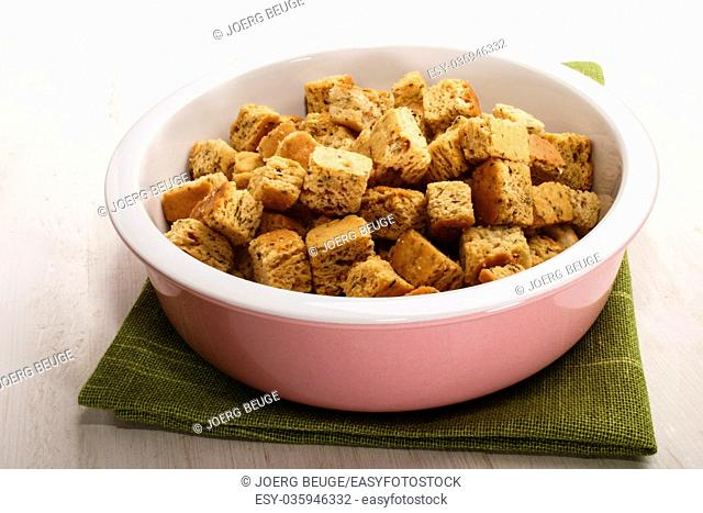 oven baked croutons in a pink and white bowl