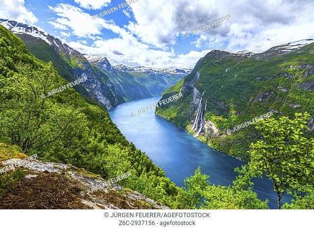 view from above to the Seven Sisters waterfall and the Geirangerfjorden with surrounding mountains, Norway
