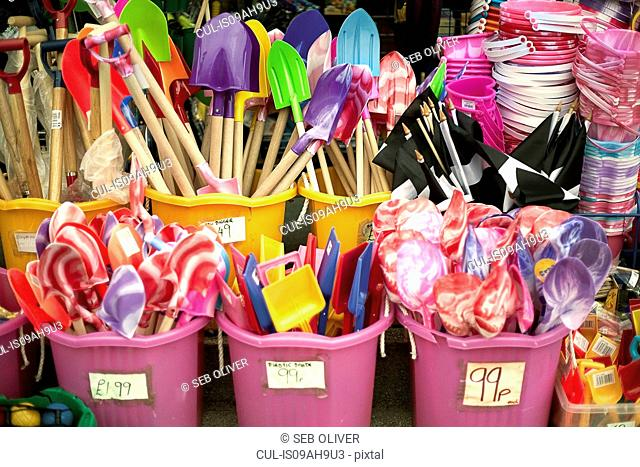 Shop display selling buckets and spades