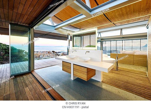 Modern luxury home showcase bathroom with ocean view